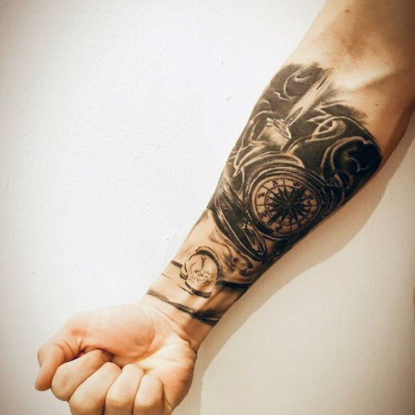 Man With Forearm Sleeve Tattoo Of Compass And Candle Flame ...