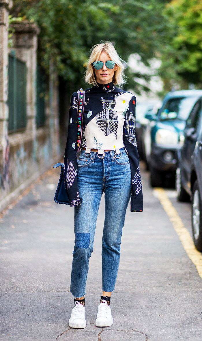 590c1f55ad9 A colorfull and funky sweater. How Fashion Girls Wear Sneakers With Jeans  via  WhoWhatWear