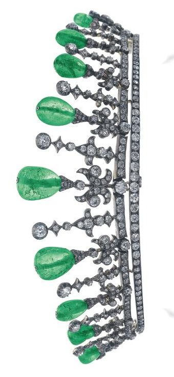 Emerald and diamond tiara, early 20th century Designed as two lines of circular-cut diamonds, surmounted with scroll and fleur de lys motifs set with cushion-shaped, circular- and single-cut diamonds, the scrolls topped with drop shaped emeralds, fitted tiara case.