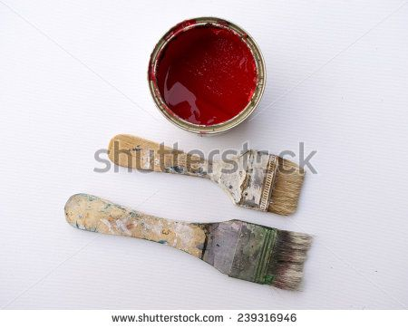 Artist brushes and bucket of red color - stock photo
