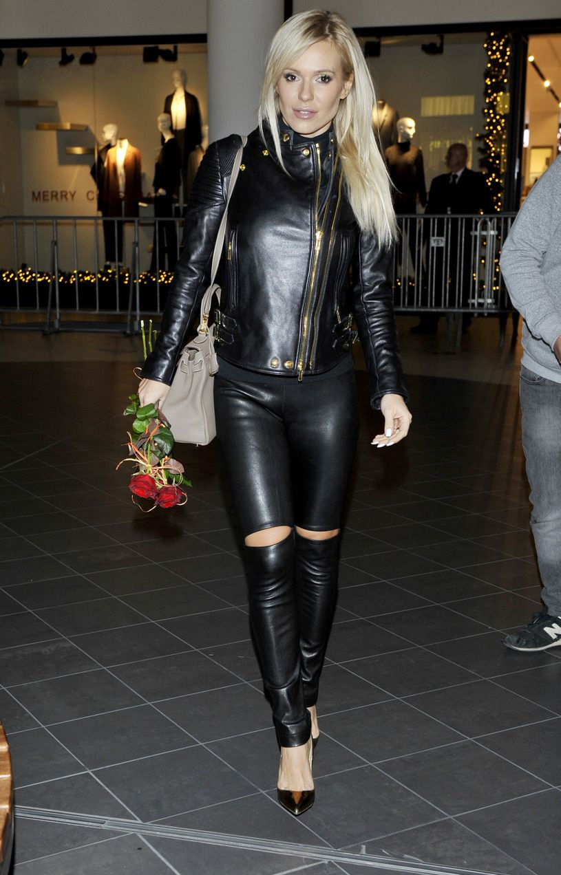 Blonde in black leather jacket with gold details leather ...
