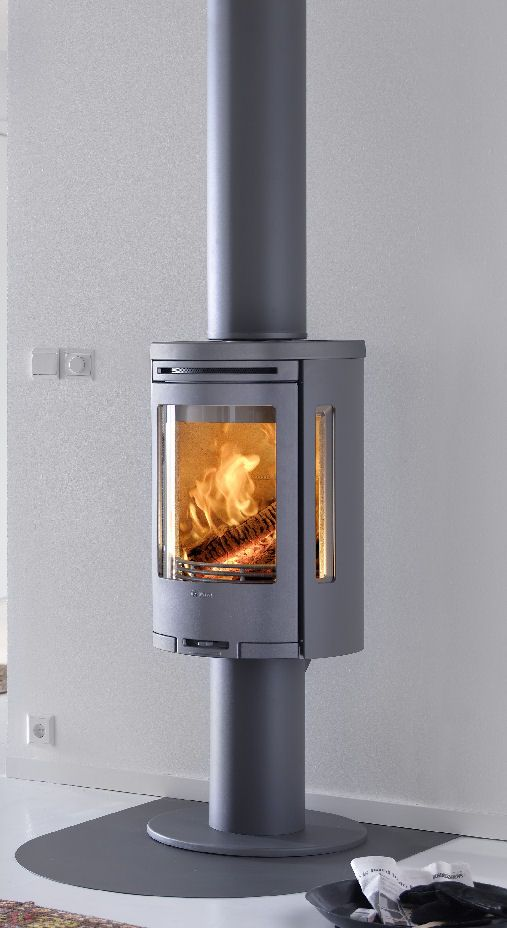 A Contura Wood Burning Stove With Pedestal And Twinwall