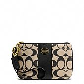 legacy small wristlet in printed signature fabric