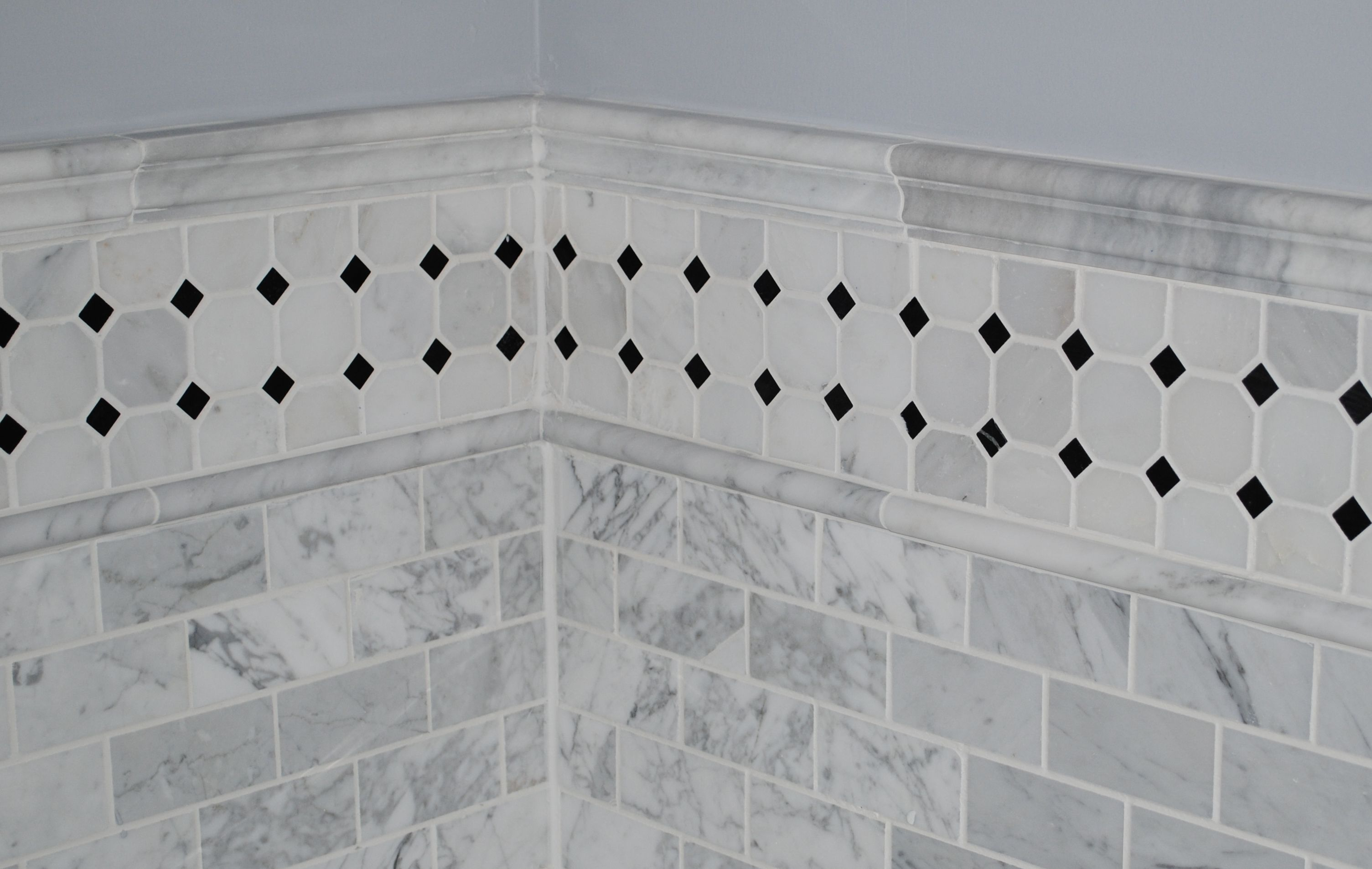 Carerra marble tub surround. Swap out the black tiles for a blue ...
