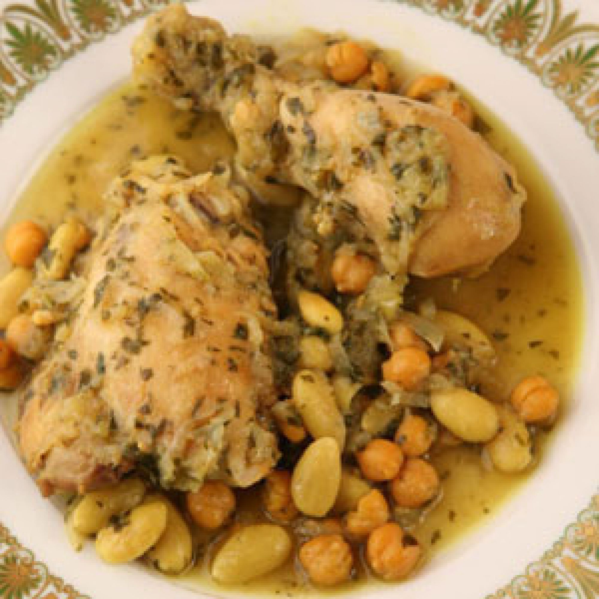 Moroccan chicken stew with almonds and chickpeas djej kdra touimiya moroccan chicken stew with almonds and chickpeas djej kdra touimiya chicken tagine recipe forumfinder Images