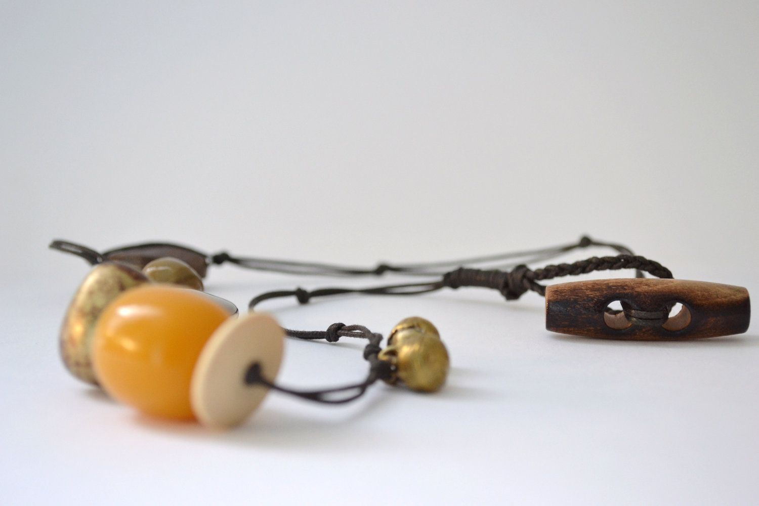 necklace in beeswax yellow and earthy tones - waxed cotton - beaded necklace with toggle closure. €23.00, via Etsy.