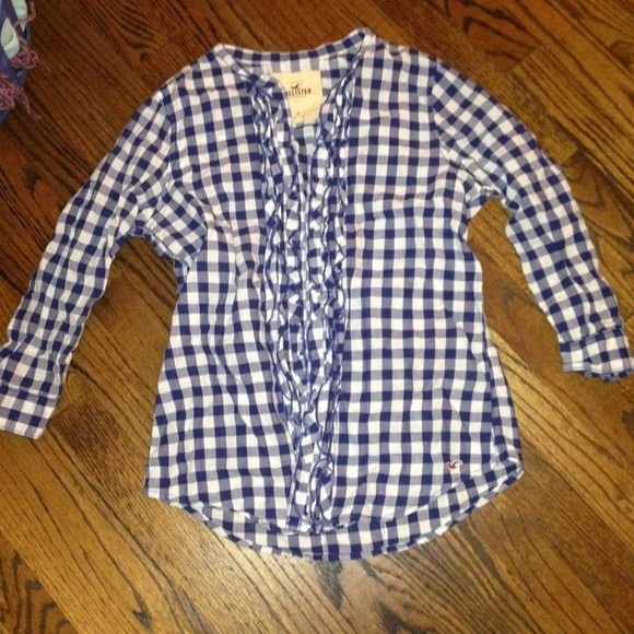 Hollister ruffle checked button down blouse Navy checks. 3/4 sleeve with ruffles down the front. Buttons at back, which can be fastened or left unfastened for a more customizable shape/fit. Hollister Tops Button Down Shirts