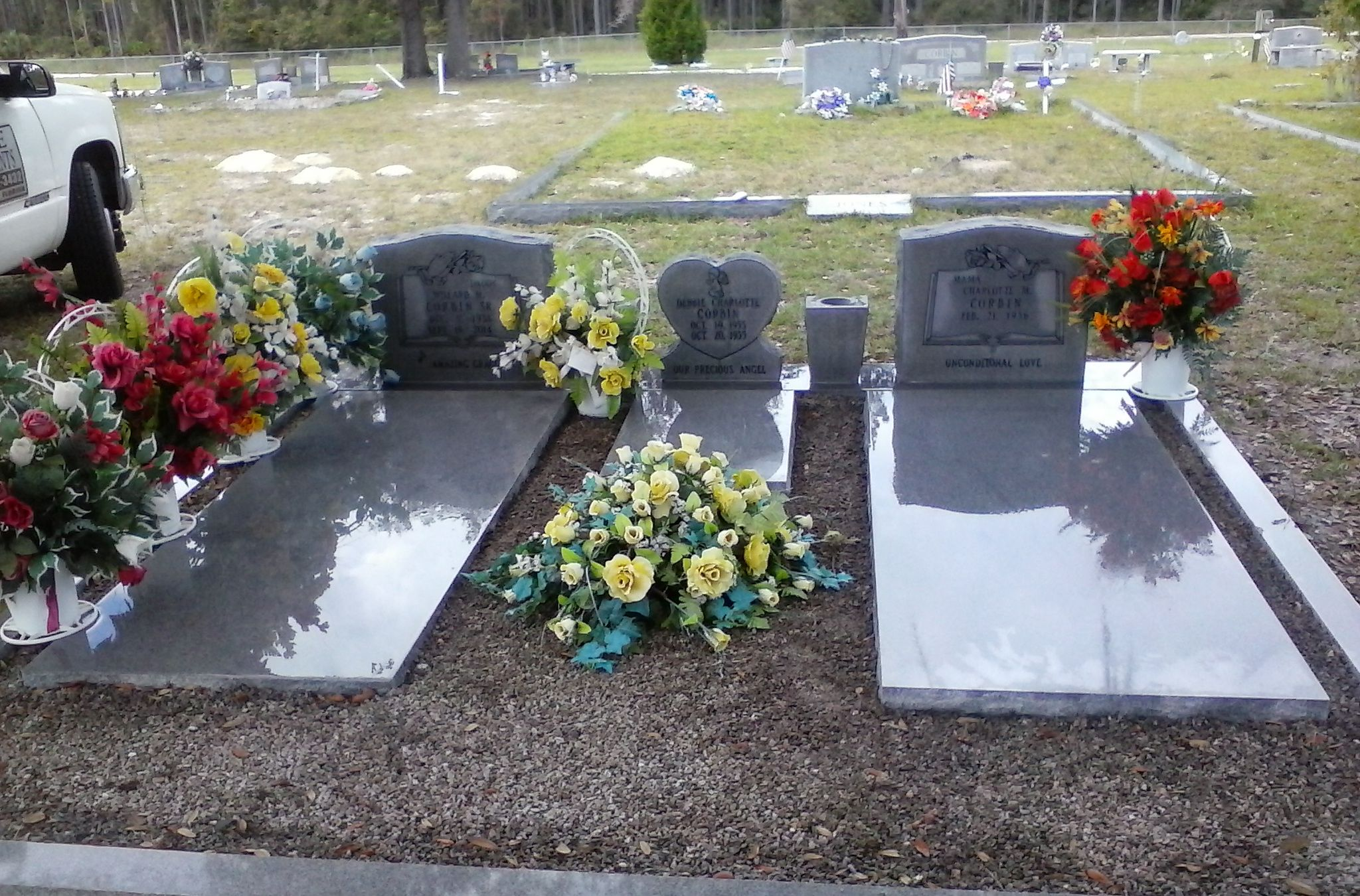 Beautiful work beautifully displayed this is grey granite serp this is grey granite serp top monuments and a small shaped heart monument in center with 2 vases 3 slabs and coping boarder with gravel reviewsmspy