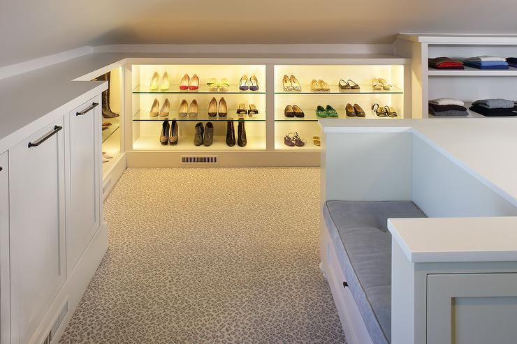 Large Walk In Attic Closet Features A White Center Island Fitted With  Drawers Donning Bronze Hardware And A Built In Bench Topped With A Gray  Velveu2026