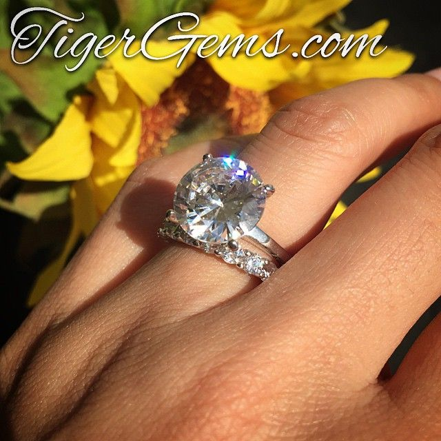 The 5 carat solitaire with the 2 carat eternity ring. ❤️ Shop now at TigerGems.com ❤️ ✨ #handmade #celebrityring #diamondring #manmadediamond#proposal #bride #groom #paris #engagementring #longhair #birthdaygirl #fitness #hawaii #ido #kimkardashian  #khloekardashian #promisering #anniversary #igers #california #nails #datenight #makeup #fitmom #bridal #wedding #bridesmaid #weddingday #photography #tigergemstones