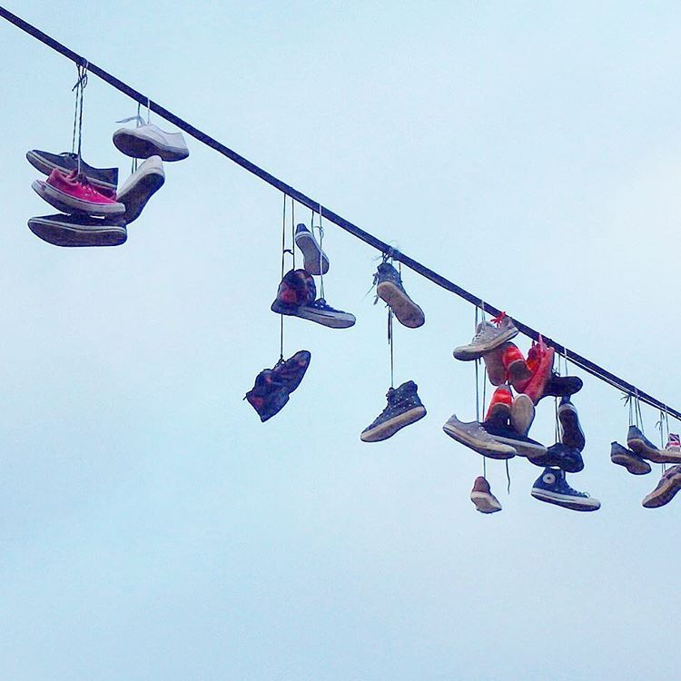 Shoes on a wire, on a hill overlooking Prague. Random sights are what make travel fun!
