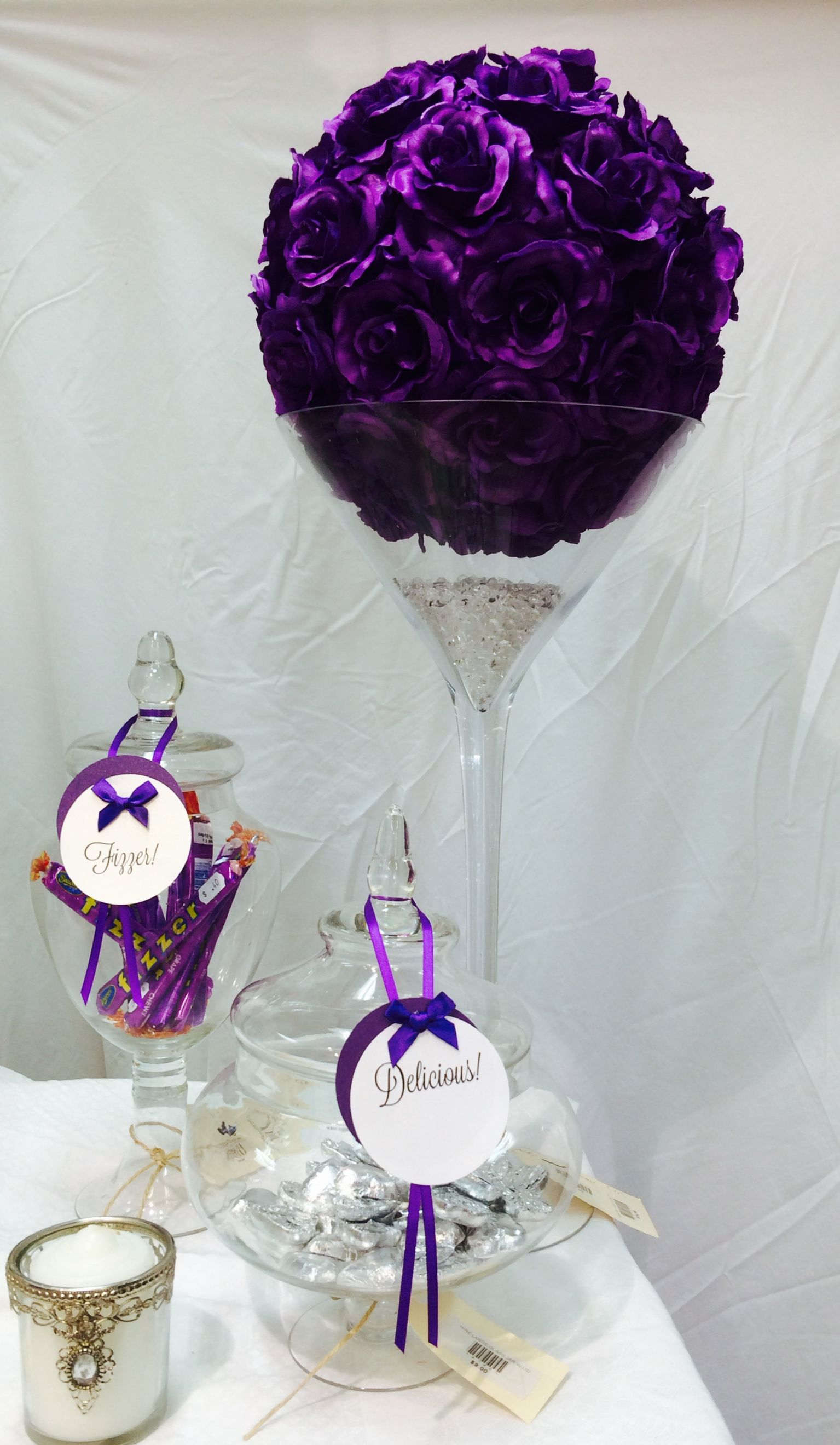 We love the purple flower balls decor on the purple lolly table