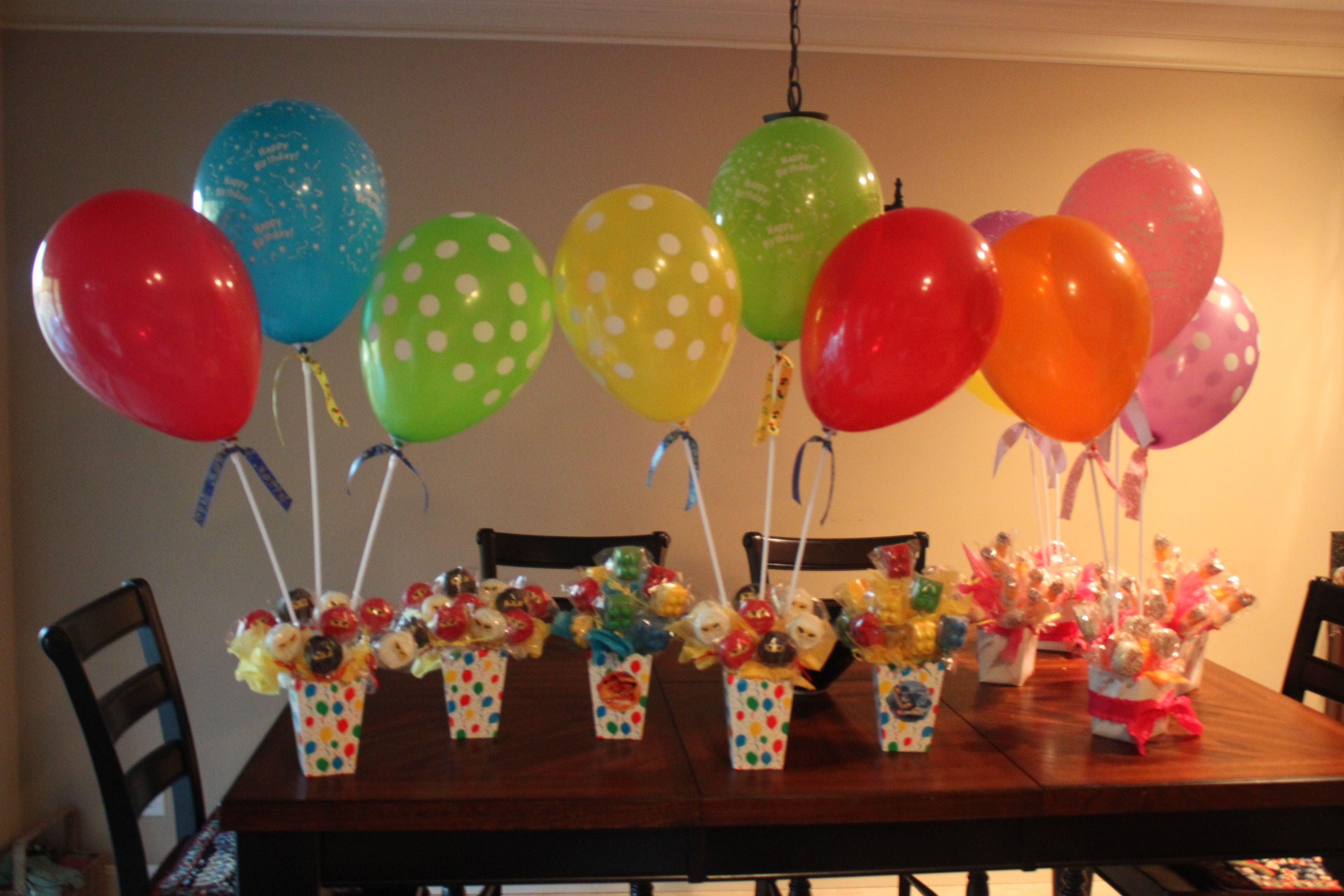 Balloon stick centerpieces for outdoor party so wind won t