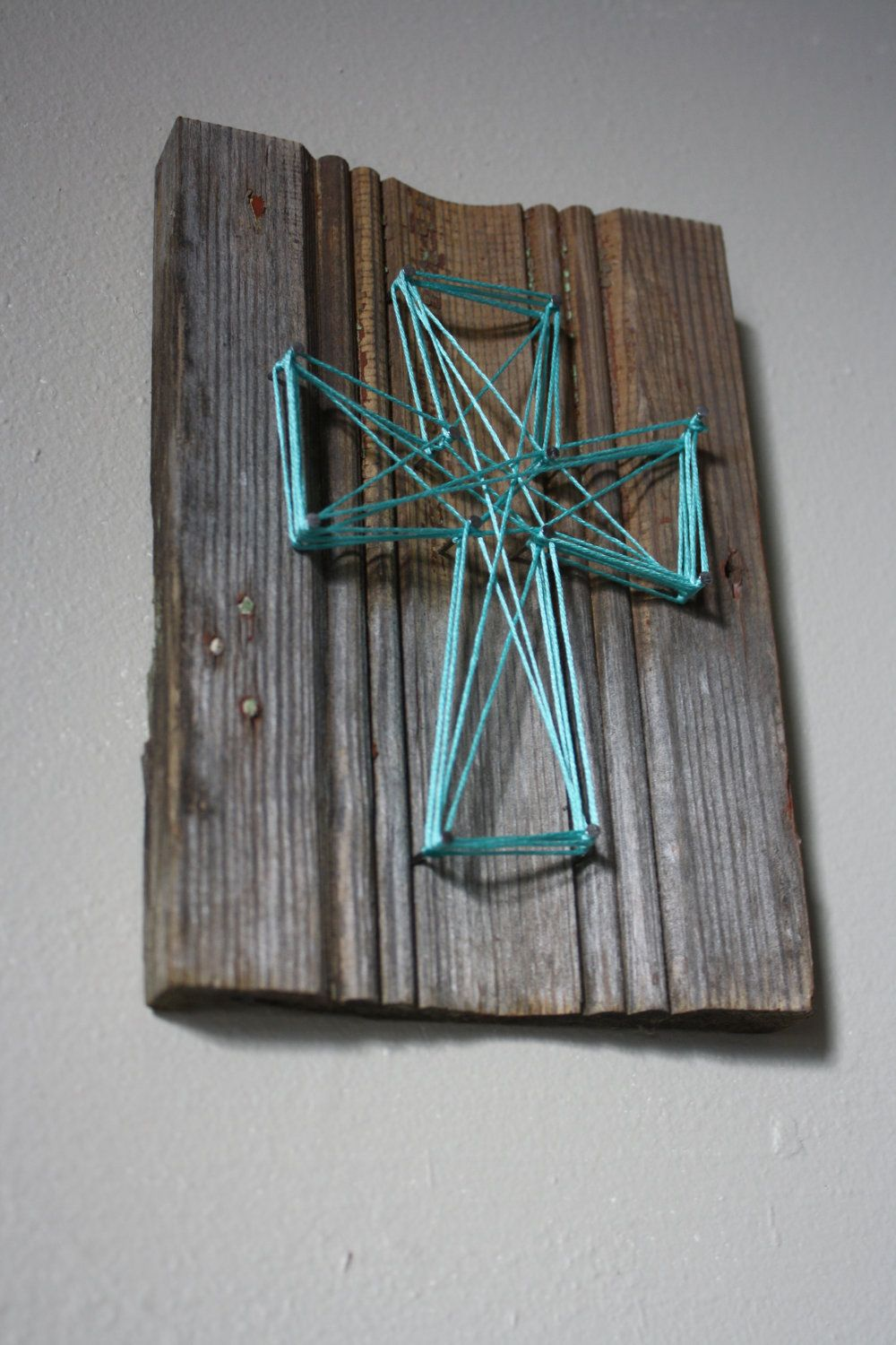 reclaimed wood trim with string art cross wall decor. $8.00, via
