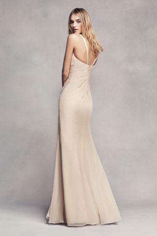 Stunning Chiffon ruffles follow the midline of this long glamorous bridesmaid dress with a sheer peekaboo