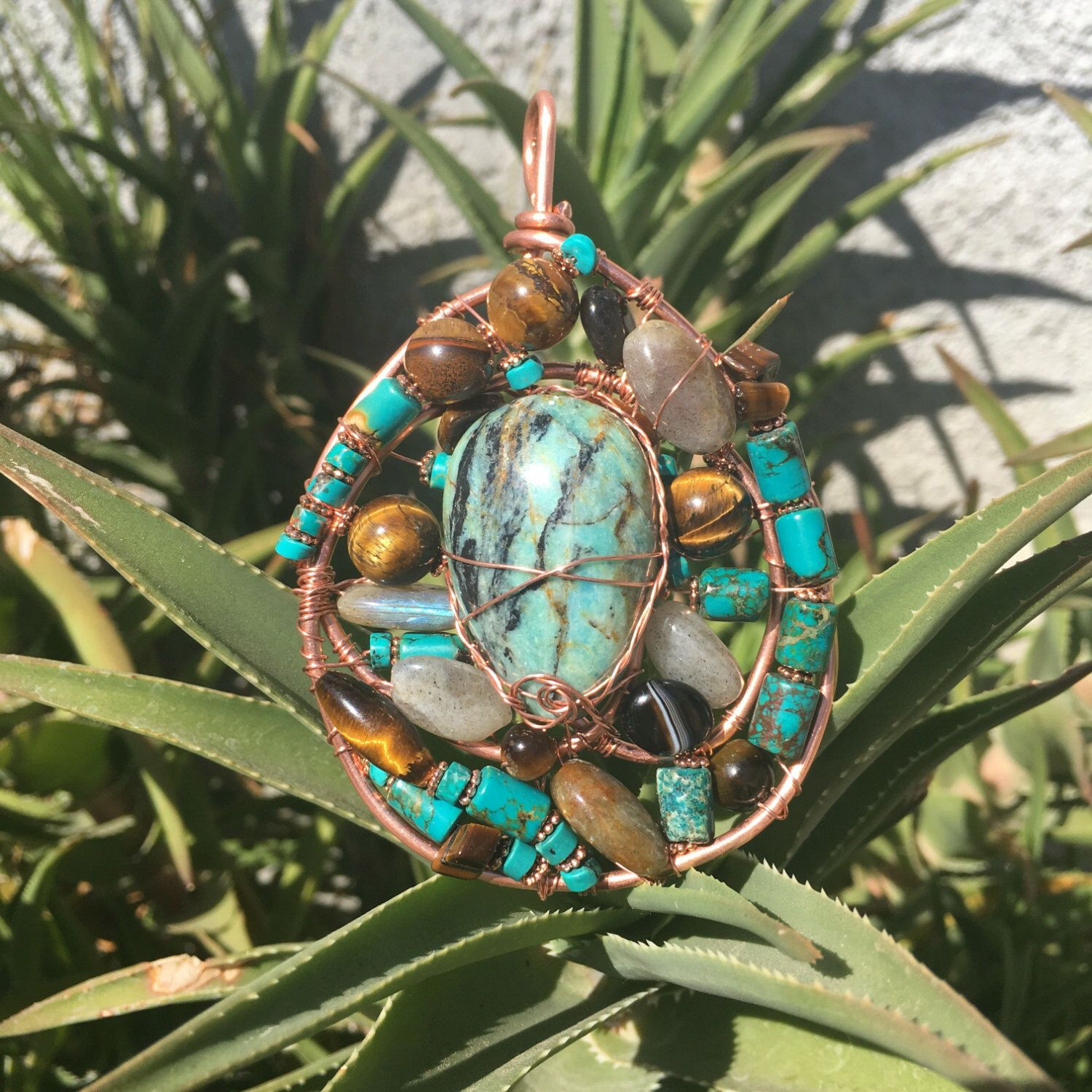 A personal favorite from my Etsy shop https://www.etsy.com/listing/476597095/turquoise-amazonite-tigers-eye