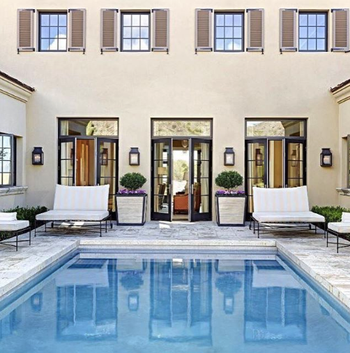 Our Mt Vernon Wall Lanterns Illuminate This Poolside Paradise Designed By David Michael Miller Courtyard Pool Architecture House Exterior