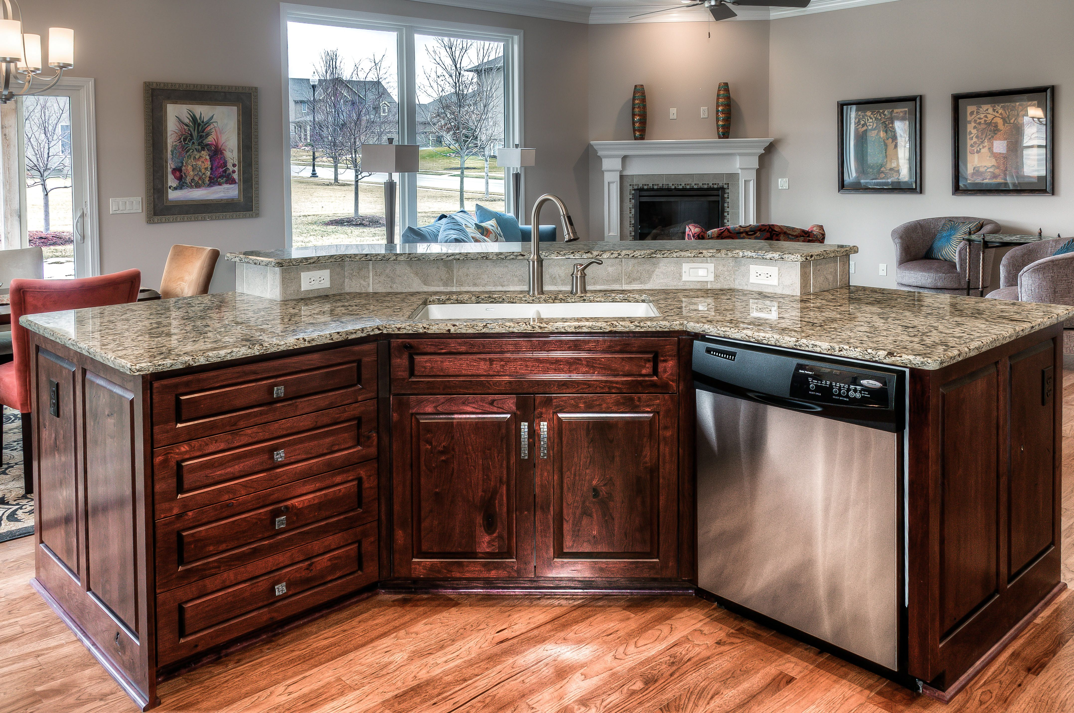Woodland Homes Kitchen Island Bat Wing Style Birch Cabinets Granite Counter Top Brushed Nickel Faucet Holds Stainless Steel Dishwasher