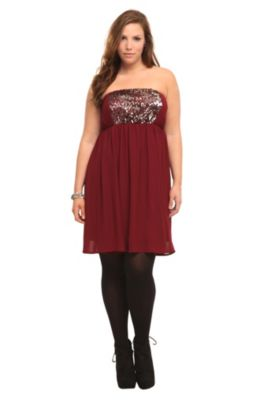 351dcde8196 A burgundy strapless dress in floating chiffon goes from simple to stunning  with a front panel of glamorous hematite and burgundy sequins.