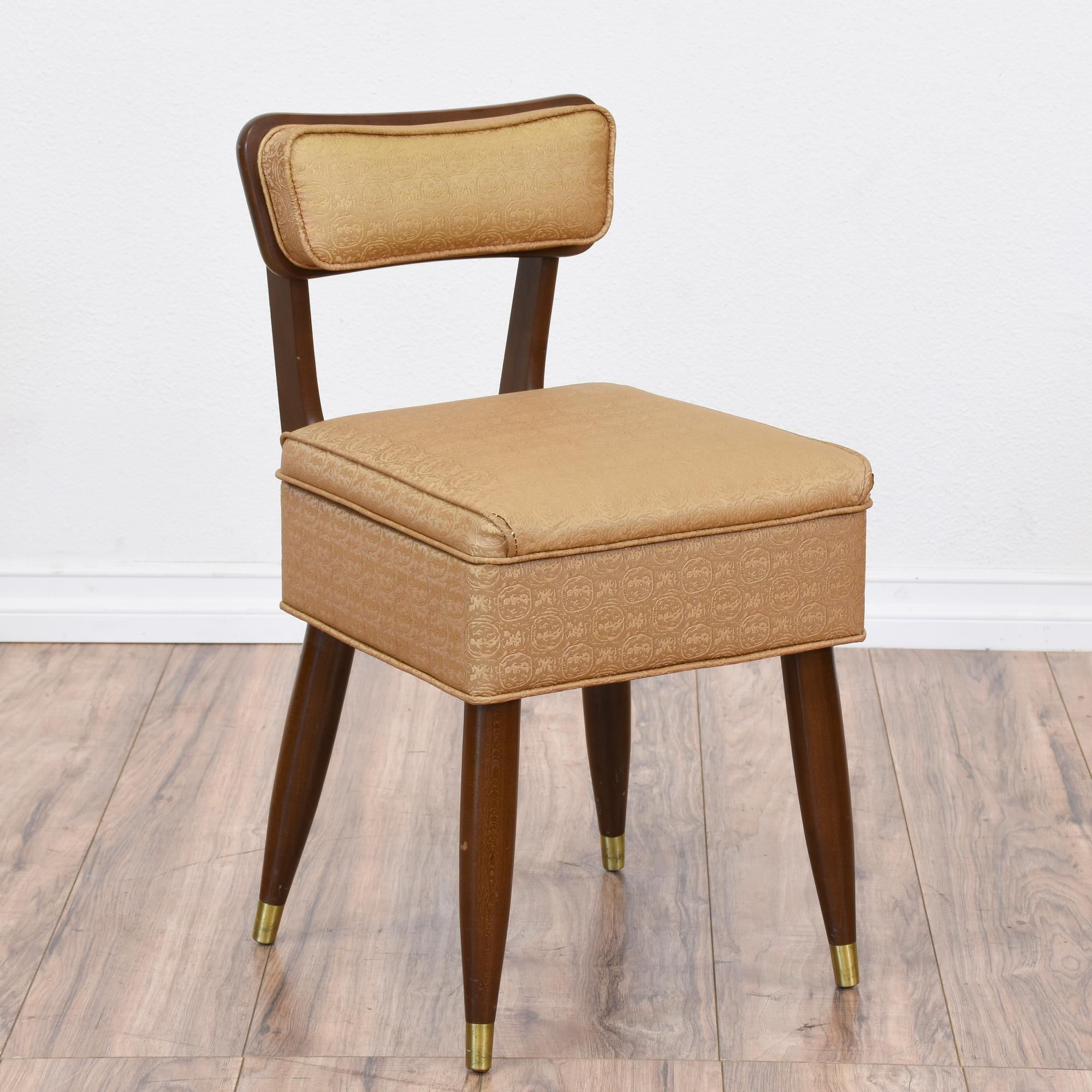 This mid century modern chair is upholstered in a durable beige