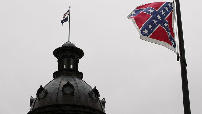 Dozens of Confederate flags were flown over public parking garages in Charleston, South Carolina, in protest after a black activist previously arrested for removing the flag from the state house flagpole was invited to speak at a local university.