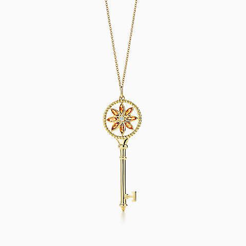 6d16964b3 Tiffany Keys daisy key pendant in gold with citrines and diamonds on a  chain.