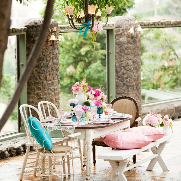 Mismatched furniture with pink, cream and turquoise/aqua colours. Beautiful