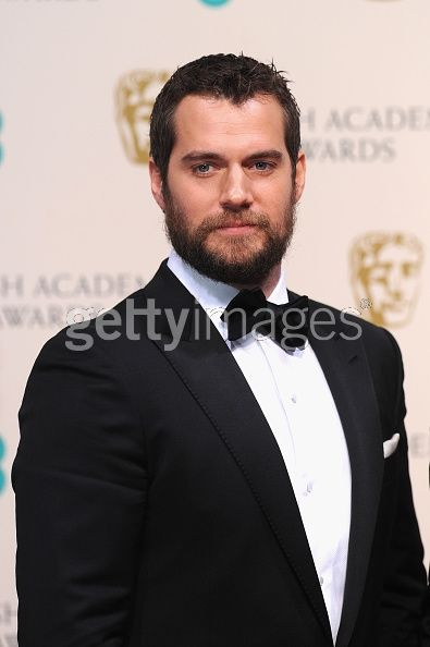 Henry Cavill poses in the...