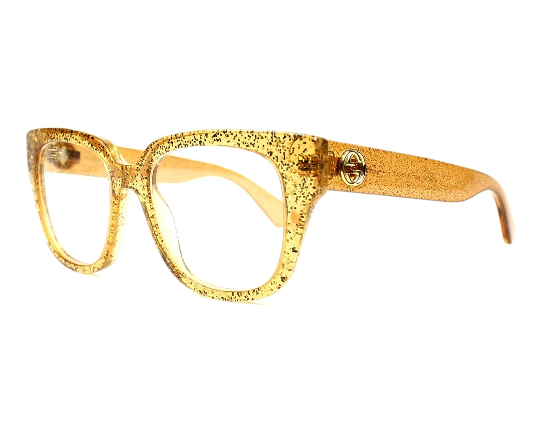 b0518537e3 Shop now for Gucci glassesGG0037O 006 Glitter Gold - Transparent Gold. Item  in stock