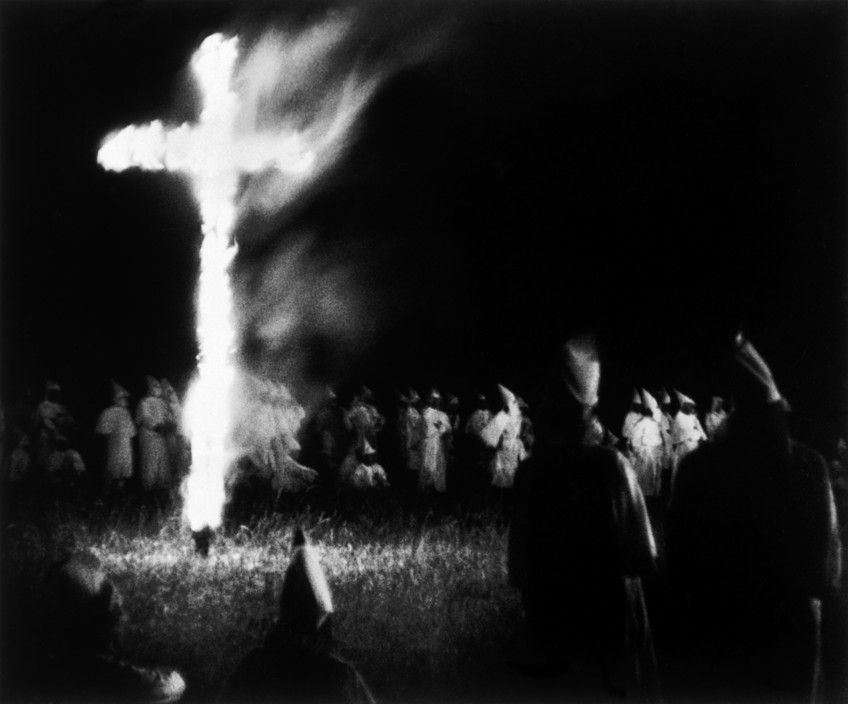 W. Eugene Smith USA. North Carolina. Ku Klux Klan meeting. 1951. The burning of the cross is one of the main rituals of the KKK.