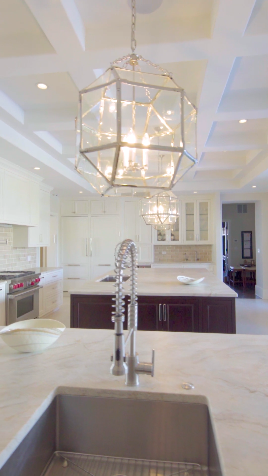 These Morris Lantern pendant lights were perfectly chosen for this custom kitchen.  The style of the lights matches the coffered ceiling while the polished nickel matches the handles and finishes throughout the space. Brighten your cooking space with custom lighting design by Amrami!