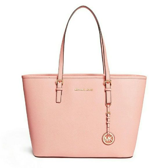 """Michael Kors Pale Pink Tote In pristine condition. Too big for my needs so I'm downsizing. Perfect pink color for Springtime! Simple, streamlined chic tote bag with a zip-top closure for extra security. 100% Cow Leather Top Handle: 9"""" Interior: 1 zip pocket, 3 open pockets, 1 cellphone pocket, 1 key fob Hard to find. I don't feel the need to mention this, but in case you're wondering, YES, this is AUTHENTIC. Make me an offer, it could be yours! :) Michael Kors Bags Totes"""