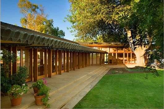Single-level ranch home with lots of glass, facing onto a back garden (see all the photos).