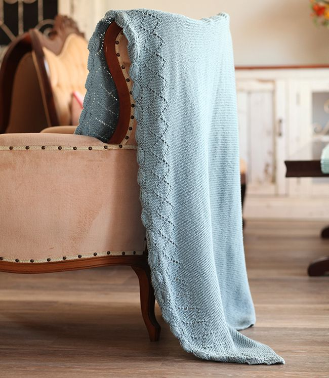 This simple Botanica Knitted Blanket pattern is fun to knit and has an elegant lace border.