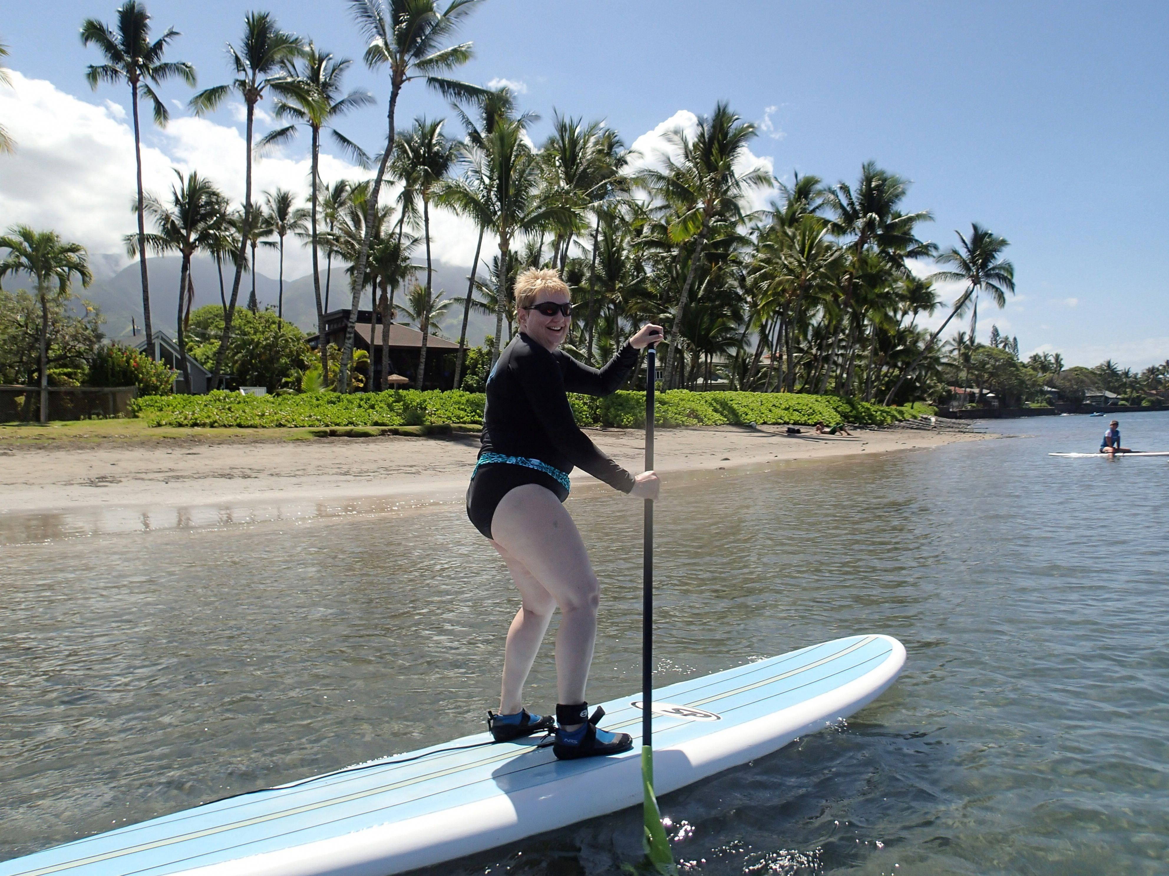 Try Stand Up Paddle Boarding with a surf champion