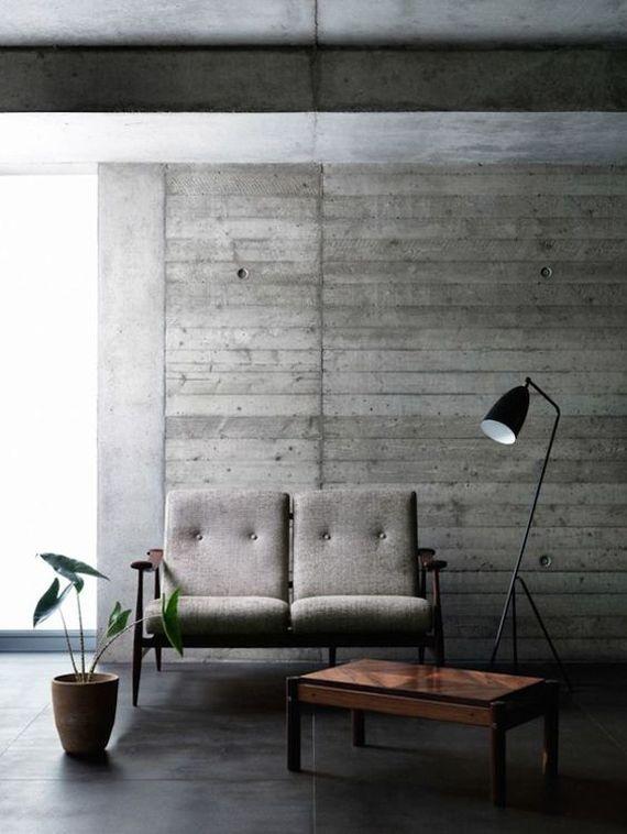 paredes de cemento sin pintar, con las marcas del encofrado - paredes de cemento