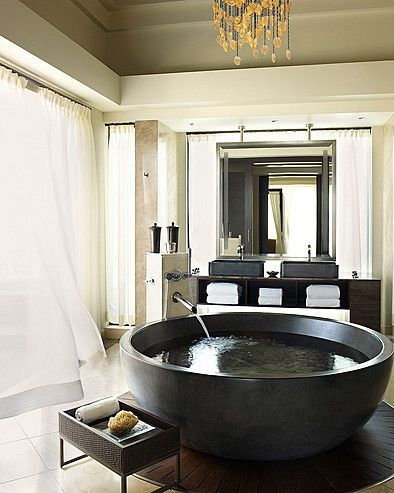 elegant chandelier and round bathtub at the four seasons hotel in