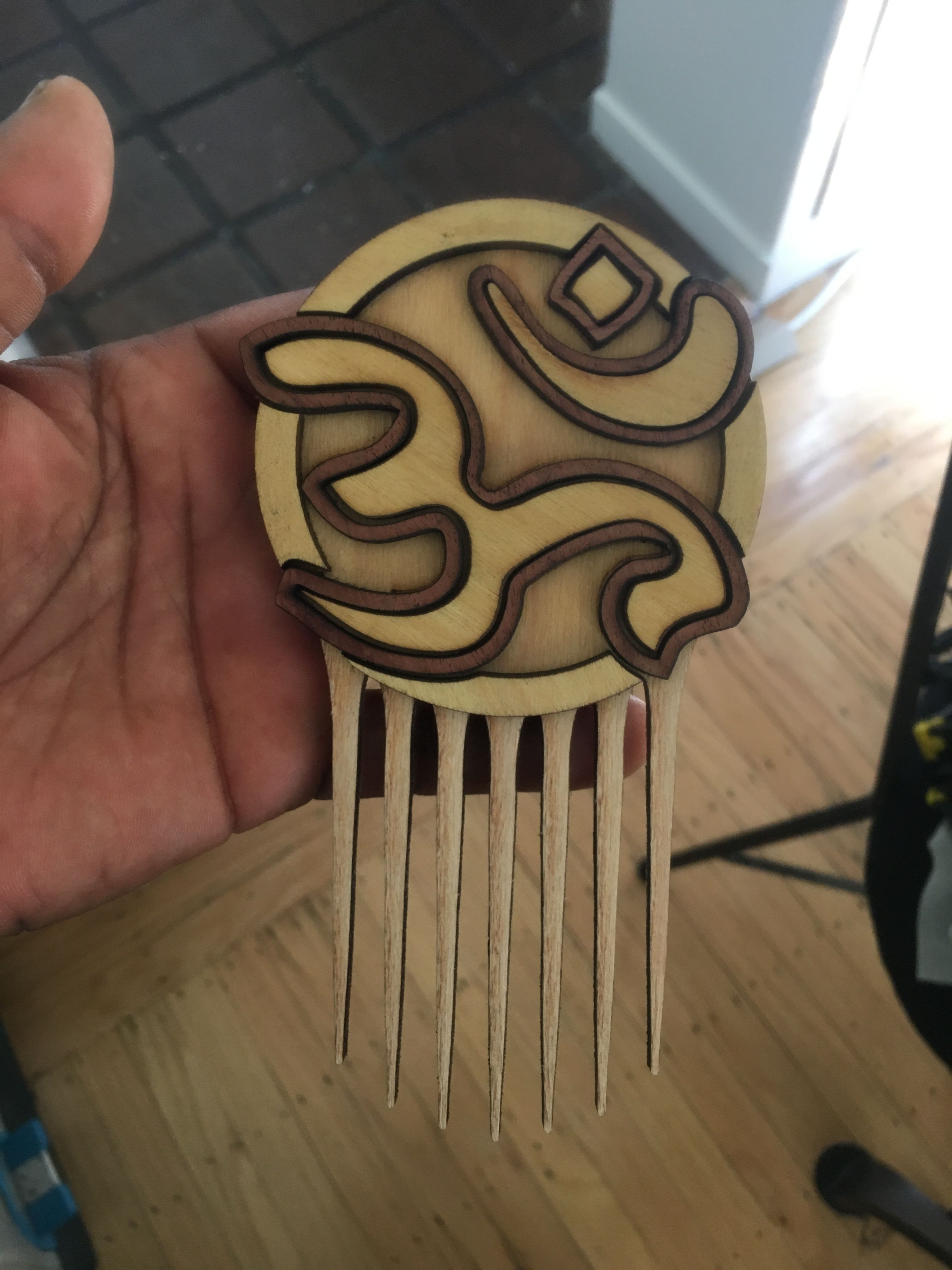 Afrofuturistic Styling Combs and Afro picks hand made from exotic hardwoods for Natural Hair, Curly Hair and Kinky Hair! www.carbon-ar.com Namaste!