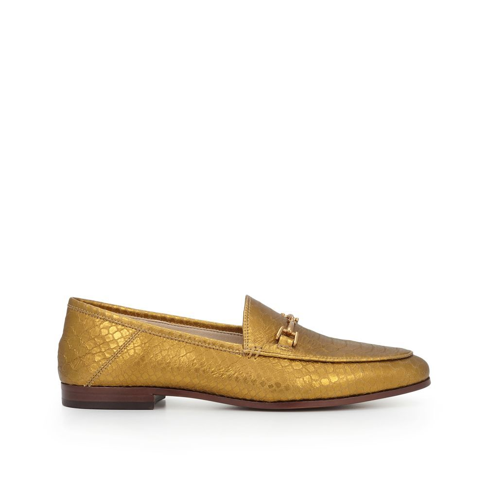a9e6389c36a34e Our Loraine Loafer is totally sophisticated and just a little bit quirky.  The sleek sole and gold hardware dress up this menswear inspired flat.