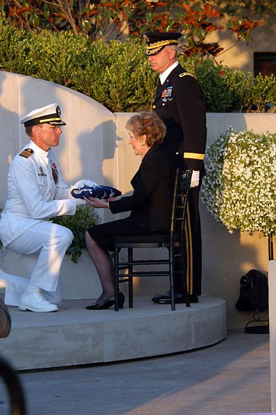 Capt. James A. Symonds, presents former President Ronald Reagan's casket flag to former First Lady Nancy Reagan.