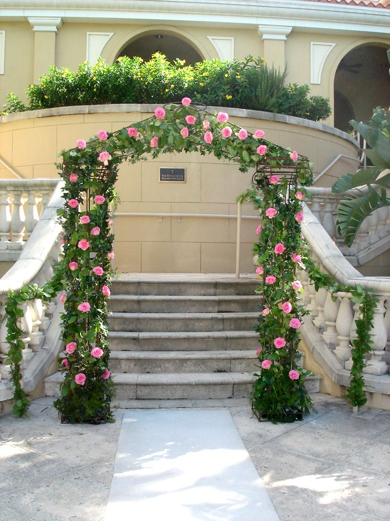 Garden wedding arch covered with ivy and pink roses shades of garden wedding arch covered with ivy and pink roses junglespirit Images