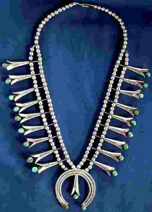 Native American Sterling & Turquoise jewelry - another style with turquoise stone set in the mouth of each blossom