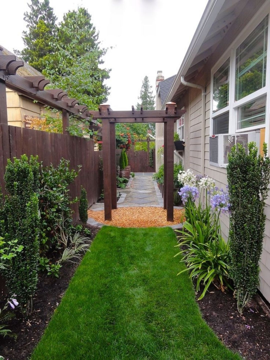 Narrow Side Yard Stepping Stones And Decorative Drainage Side Yard Landscaping Small Backyard Landscaping Cottage Garden Design