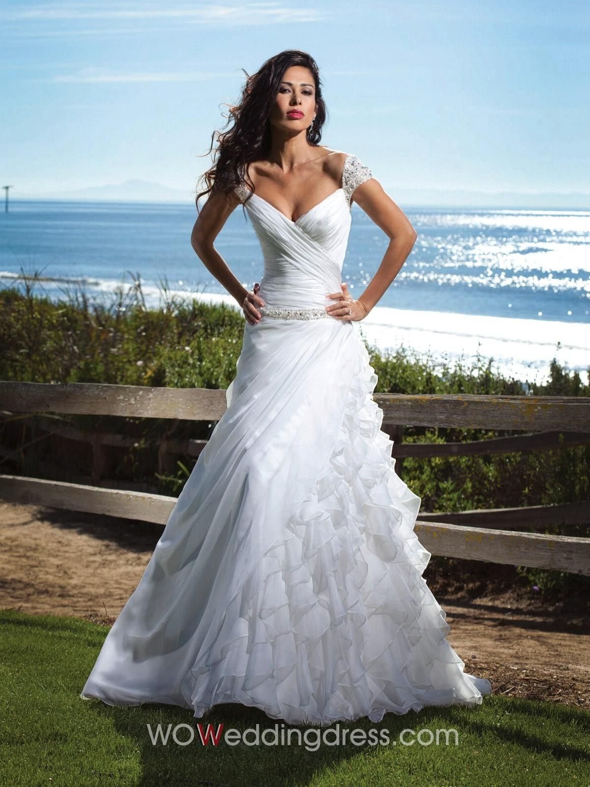 Wedding dresses with ruffles on skirt  Beachy cap sleeve lace wedding dress wow if i could pull this