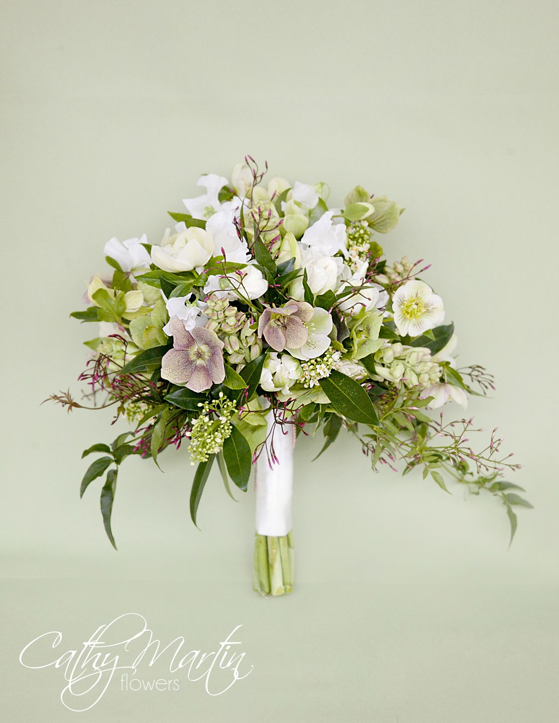 Love this beautiful bouquet featuring hellebores niagara flowers hellebores skimmia tulips sweetpea and jasmine in this cathy martin flowers bouquet early spring izmirmasajfo