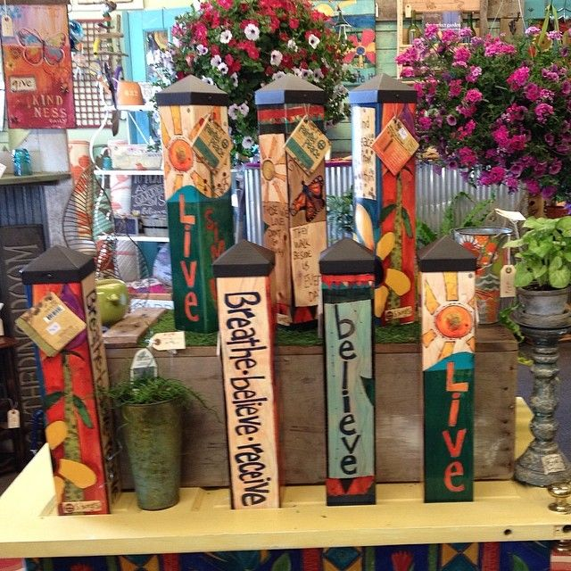 dress up your garden with art poles gardening junky
