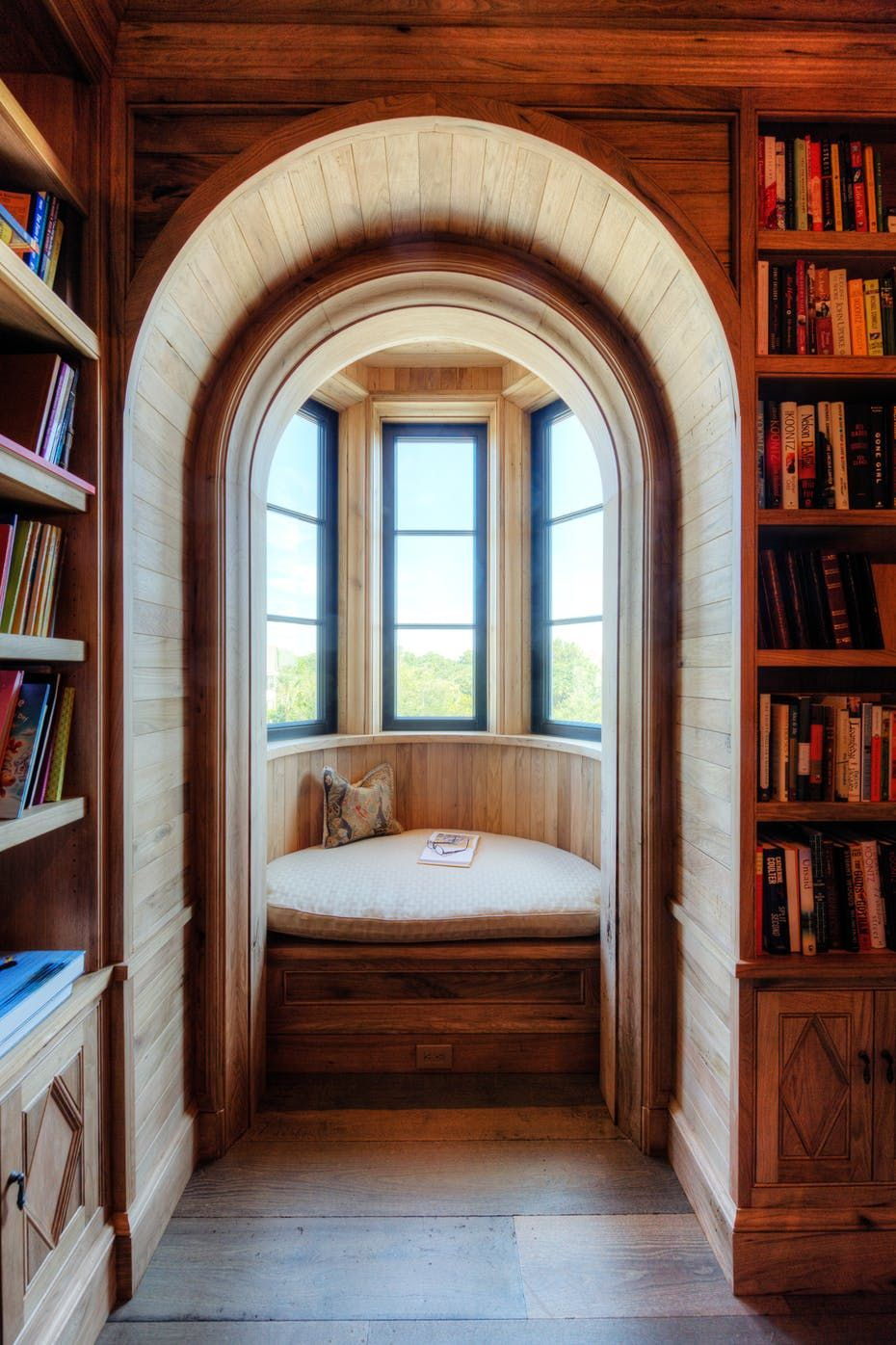 Window Seat Library: Arched Opening Into Curved Bay Window Seat In Natural Wood