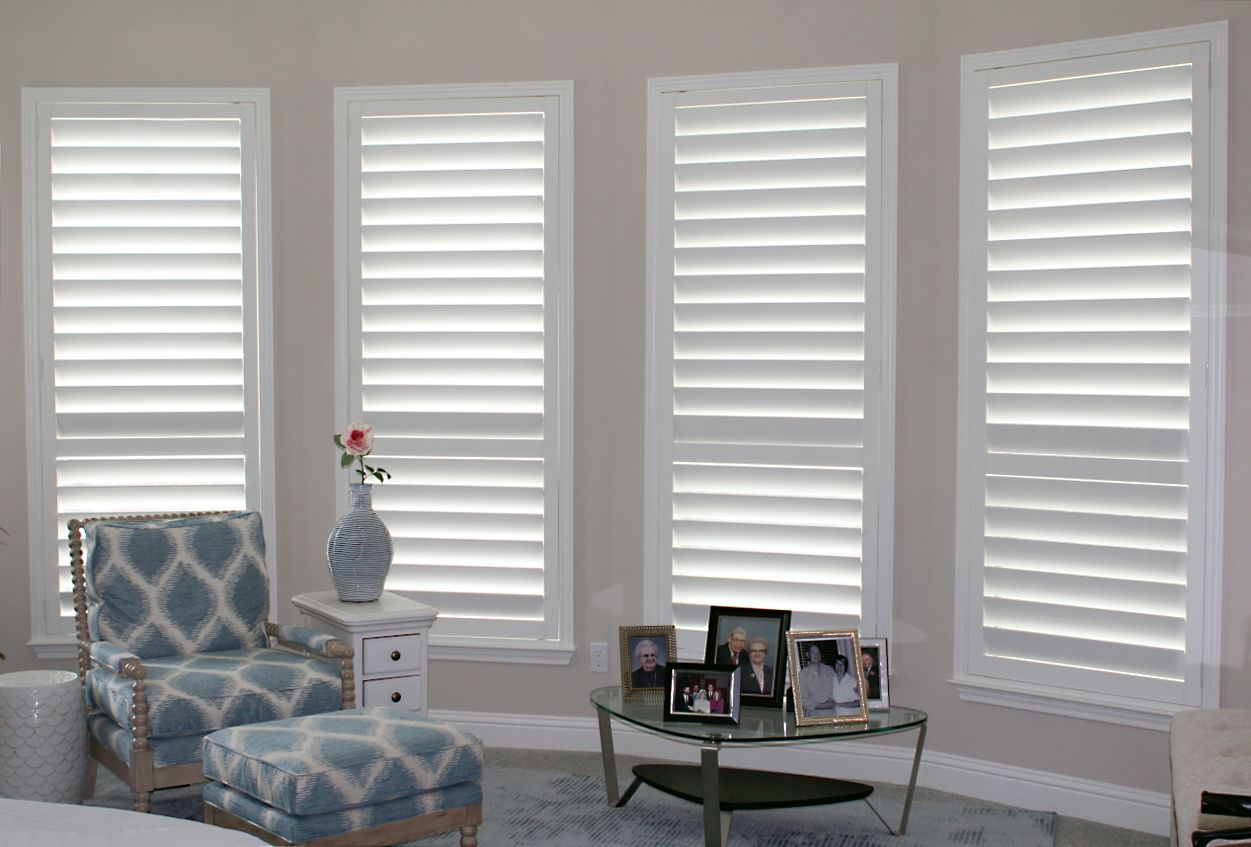 Real wood plantation shutters in the master bedroom make