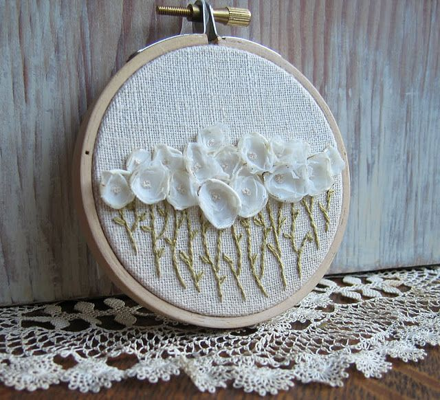 So many things to love about this... needlepoint hoop as a frame, little frilly flowers...