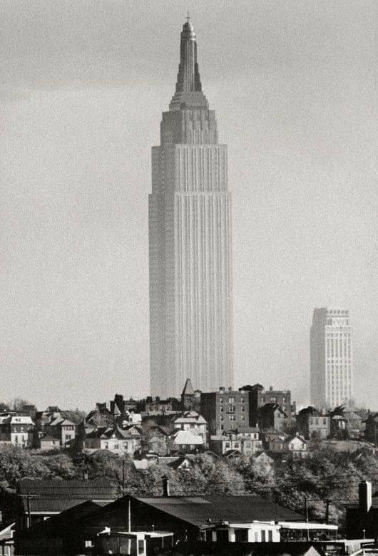 A lonely Empire State Building in New York City, 1941.   Black ...